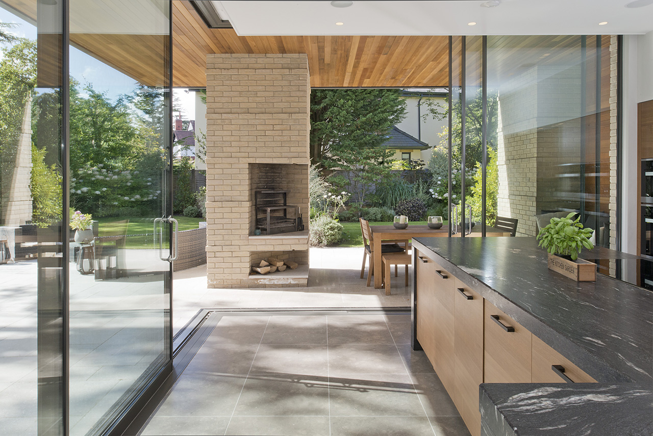 Photo of the kitchen and outdoor area of a private house in Cheshire, by Positive Image